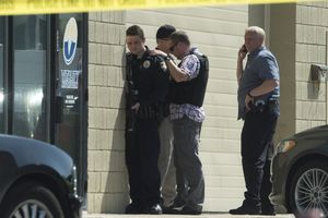 (Rick Egan | The Salt Lake Tribune) Bountiful police investigate after they say a store clerk shot an armed robbery suspect at Bountiful Pawn and Sales on Thursday, May 3, 2018. Police are looking for a second suspect in the attempted armed robbery.