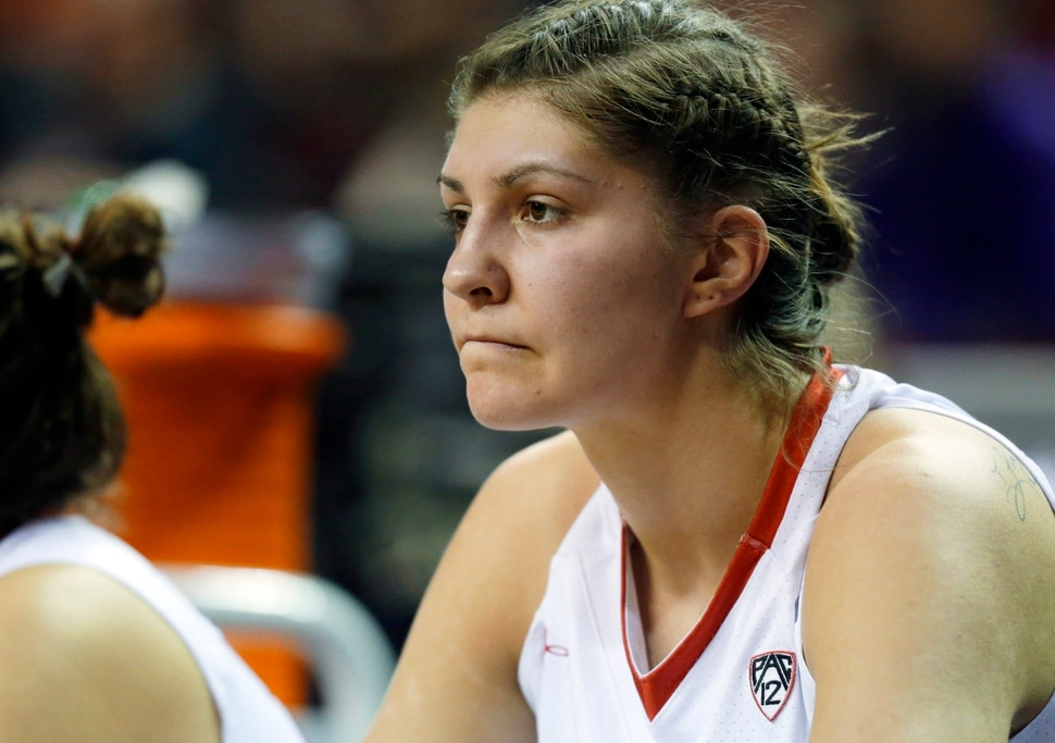 Utah forward Emily Potter sits on the bench after fouling out during overtime of an NCAA college basketball game against California in the Pac-12 Conference tournament, Thursday, March 3, 2016, in Seattle. California beat Utah 66-63 in overtime. (AP Photo/Ted S. Warren)