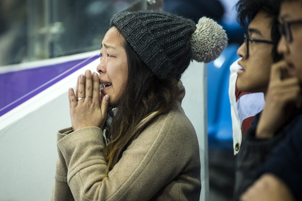 (Chris Detrick | The Salt Lake Tribune) Nathan Chen's sister Alice Chen, left, reacts as his score is announced in the Men Single Skating Free Skating at Gangneung Ice Arena during the Pyeongchang 2018 Winter Olympics Saturday, Feb. 17, 2018. Chen landed a record six quadruple jumps, scoring 215.08. At right are his brother Colin Chen and cousin Kevin Wang.