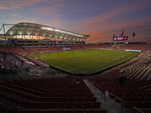 The sun sets above Rio Tinto Stadium before an MLS soccer match between Real Salt Lake and Portland Timbers Wednesday, Oct. 14, 2020, in Sandy, Utah. (AP Photo/Rick Bowmer)