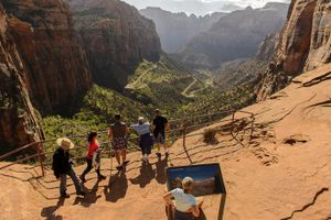 (Trent Nelson | The Salt Lake Tribune) In this May 5, 2015, photo, hikers walk on the Canyon Overlook Trail in Zion National Park.