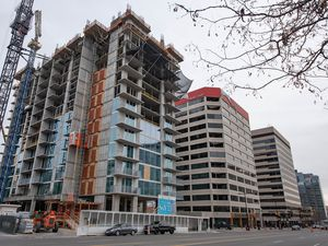 (Francisco Kjolseth  |  Tribune file photo) Liberty Sky, a luxury apartment tower going up at 151 S. State.  Although apartments are being built at a record pace, experts say the added housing supply will take years before it starts bringing down rents.
