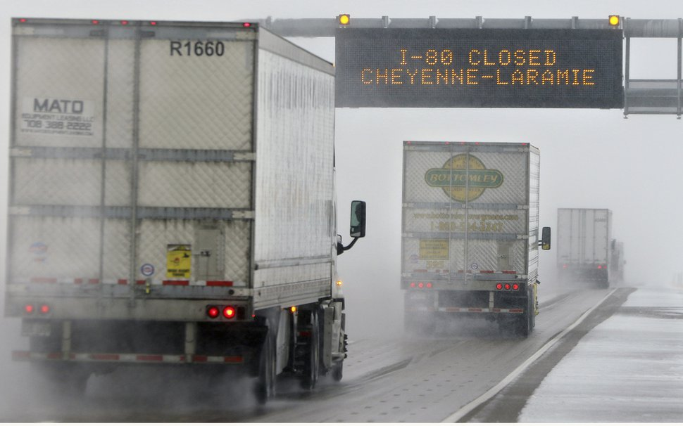 (Blaine McCartney | File photo by The Wyoming Tribune Eagle via AP) Truck drivers head toward Cheyenne, Wyo., in 2016 in limited visibility. Long-haul truck drivers are among those finding smaller tax refunds because of changes in business deductions they may claim.