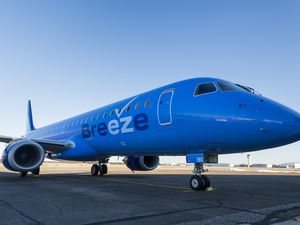 (Adam Macchia | The New York Times) A Breeze Airways commercial airliner at an airport on New York's Long Island, March 2, 2021. Breeze Airways, a low-fare carrier that started flying less than three months ago, said Wednesday, Aug. 18, 2021, that it had raised $200 million, bringing its total capital to more than $300 million.