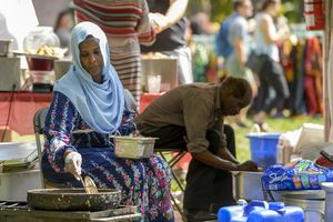 (Leah Hogsten  |  The Salt Lake Tribune)  Rabab Omer frys falafel and other Sundanese foods during the 4th Annual African Festival sponsored by the United Africans of Utah on Saturday at Liberty Park. The African Festival promotes African tradition, culture and heritage through the arts, food fashion, music and dance.