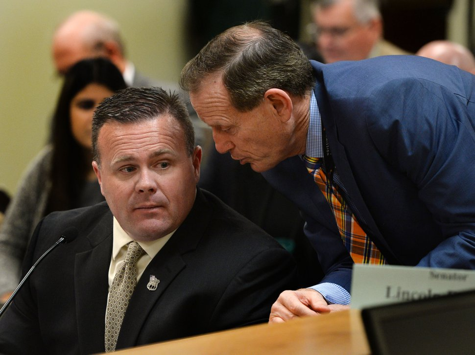 Steve Griffin / The Salt Lake Tribune Brad Dee, Utah Communications Authority legislative liaison, right, talks with Utah Communications Authority executive director David Edmunds, during the Executive Offices and Criminal Justice Appropriations Subcommittee meeting in the House Building Room 25, on Capitol Hill in Salt Lake City Thursday February 2, 2017. The communications authority was rocked by a $1 million embezzlement scandal earlier this year.