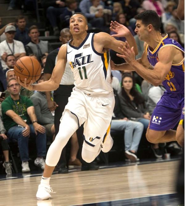 (Rick Egan | The Salt Lake Tribune) Utah Jazz guard Dante Exum (11) takes the ball to the hoop, as Sydney Kings guard Kevin Lisch (11) defends, in preseason basketball action, Utah Jazz vs. Sydney Kings, in Salt Lake City, Sunday, October 2, 2017.