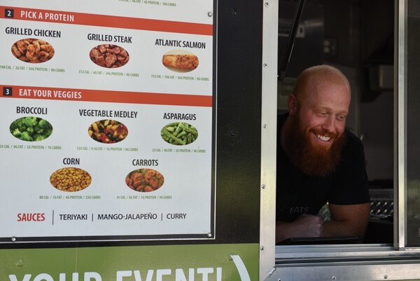 (Francisco Kjolseth | The Salt Lake Tribune) Co-owner Jared Trust takes orders at the CleanEats food truck, which serves healthy meals with lean proteins and fresh vegetables.