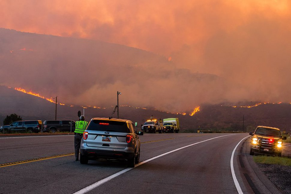 (Courtesy of Duchesne County Sheriff's Office) Emergency responders watch as the Dollar Ridge Fire nears Highway 40 near Fruitland on Wednesday, July 4, 2018. The fire later crossed the road, forcing crews to close the highway.