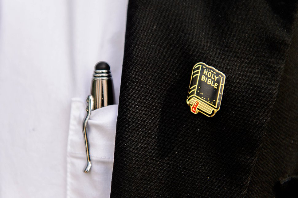 Trent Nelson | The Salt Lake Tribune A Holy Bible pin on the suit of Winston Blackmore, as he leaves court in Cranbrook, B.C., Tuesday April 18, 2017. Blackmore and co-defendant James Oler are the first fundamentalist Mormons to be tried for polygamy in Canada.