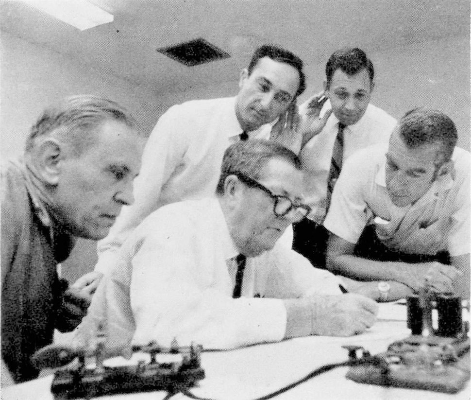 (AP file photo) In this May 10, 1969, file photo, Associated Press White House correspondents Doug Cornell, left, and Frank Cormier, right, watch as Western Union officials receive a direct wire Morse message in Miami from Promontory, Utah. The message was a duplicate of the one sent 100 years earlier after the completion of the first railroad transcontinental link. Another message was sent to President Nixon nearby in Key Biscayne, Fla., like the one sent to President Grant 100 years earlier.