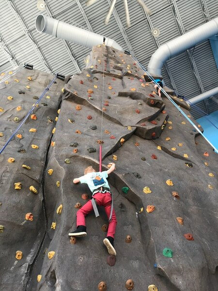 (Heather May | Special to The Tribune) Luke, 8, climbs at iRock Utah in Ogden.
