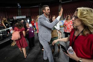 (Francisco Kjolseth | The Salt Lake Tribune) Carson Jorgensen gives high fives after it is announced that he is the new Utah Republican Chairman following long awaiting voting during the party's convention at the Maverik Center in West Valley City on Saturday, May 1, 2021.
