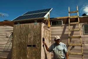(Chris Detrick | Tribune file photo) In this 2010 file photo, Albert Cly, 71, shows off the solar electricity panels he installed in his home in the Westwater Navajo community. The 16 residents of Westwater live without running water or electricity, despite the community's proximity to Blanding.