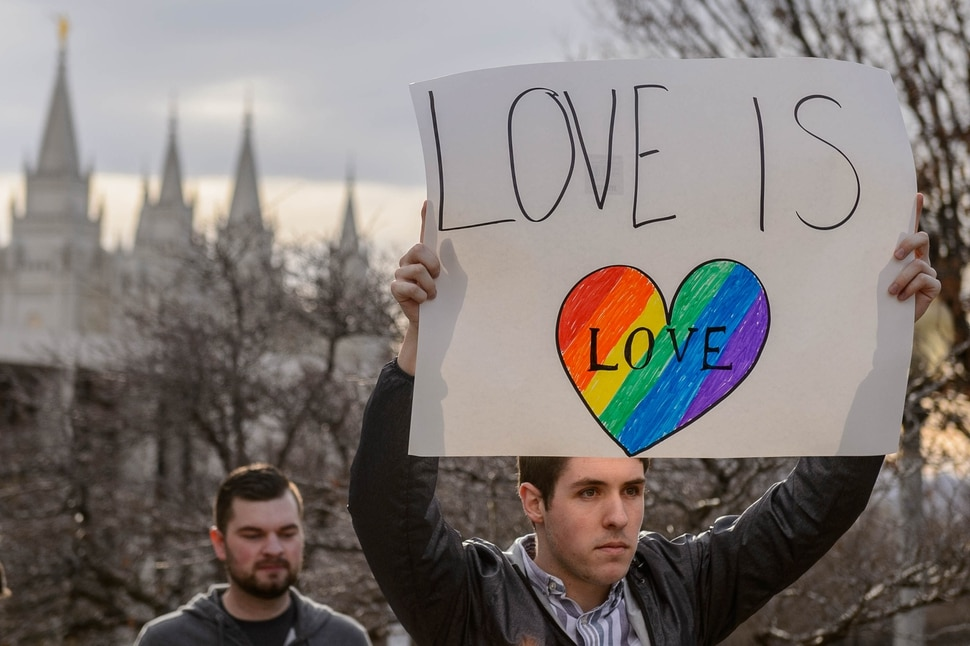 "(Trent Nelson | The Salt Lake Tribune) Demonstrators at a rally about BYU's changing position on ""romantic behavior"" by same-sex couples gather in City Creek Park in Salt Lake City on Friday, March 6, 2020."
