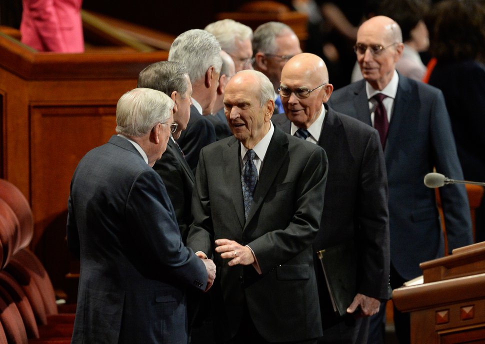 (Francisco Kjolseth | The Salt Lake Tribune) President Russell M. Nelson, center, greets President M. Russell Ballard, acting president of the Quorum of the Twelve Apostles while followed by President Dallin H. Oaks, first counselor in the First Presidency and Henry B. Eyring, second counselor in the First Presidency for the start of the Sunday afternoon session of the 189th twice-annual General Conference of The Church of Jesus Christ of Latter-day Saints at the Conference Center in Salt Lake City on Sunday, Oct. 6, 2019.