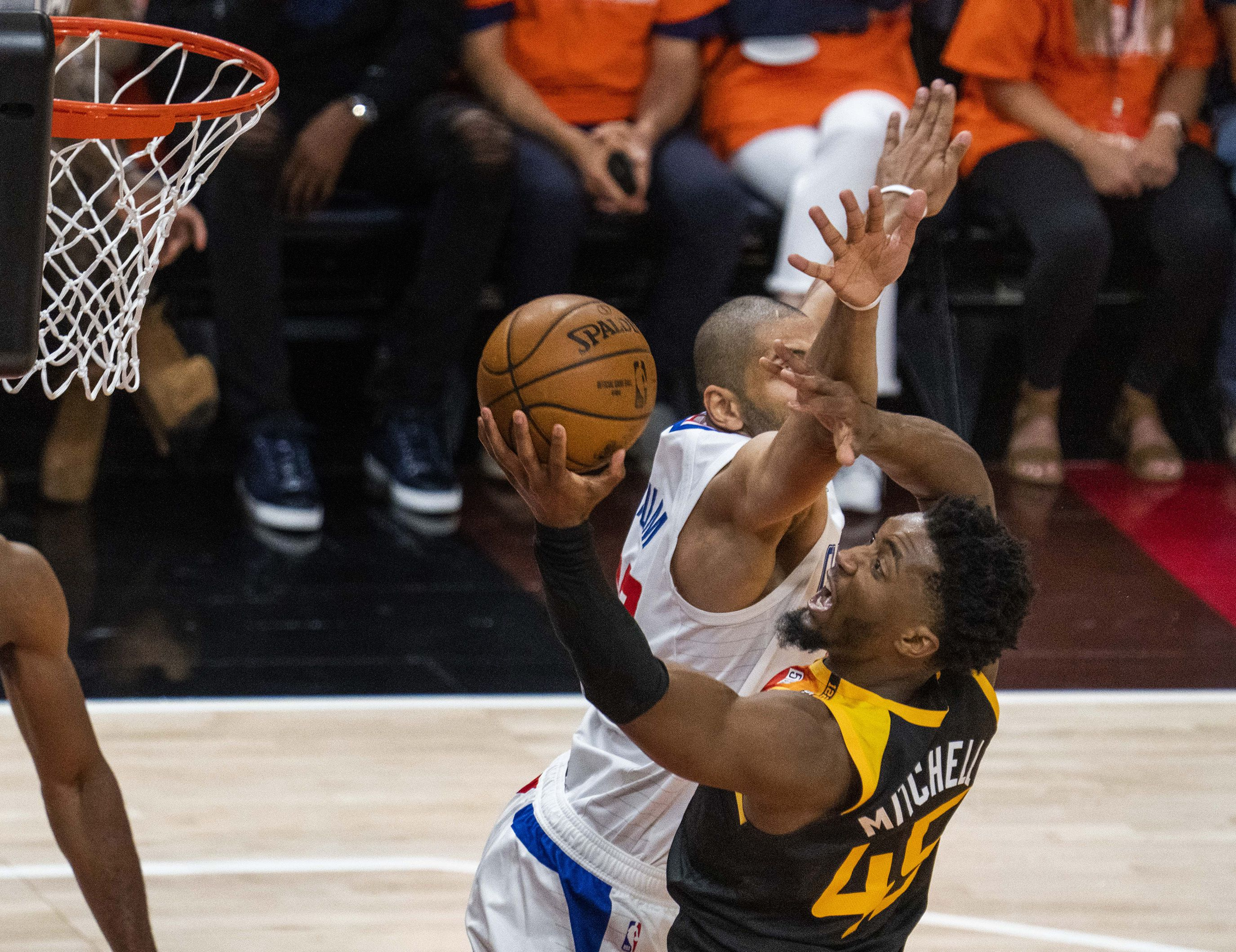 (Rick Egan | The Salt Lake Tribune) Utah  guard Donovan Mitchell (45) shoots as LA Clippers forward Nicolas Batum (33) defends, in second round playoff action in game 2 between the Utah Jazz and the LA Clippers, at Vivint Arena, on Thursday, June 10, 2021.