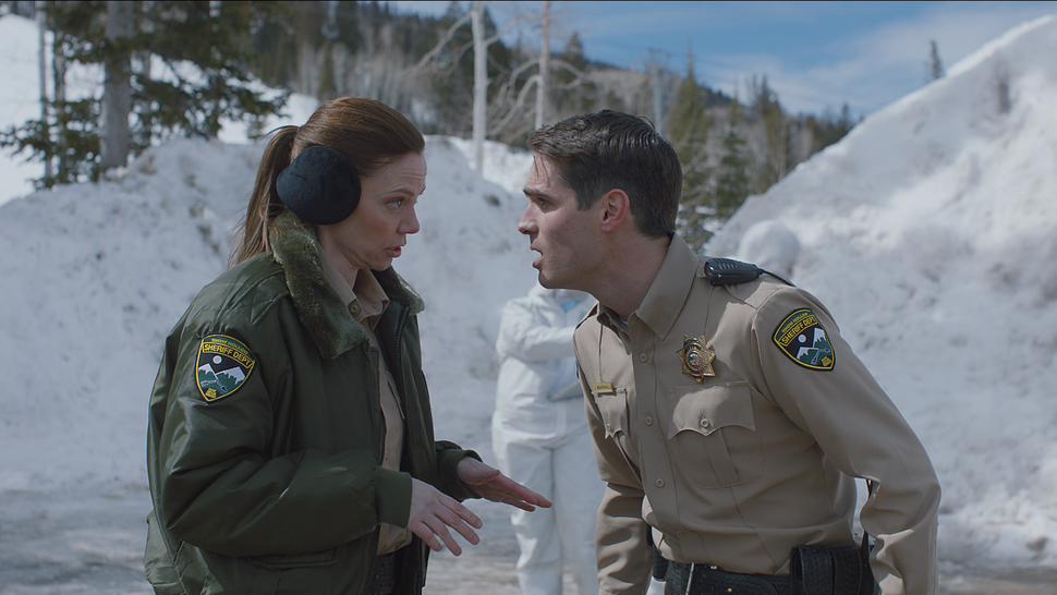 (Photo courtesy of Orion Classics) Deputies Julia Robson (Riki Lindhome, left) and John Marshall (Jim Cummings) deal with a bloody murder scene, in the filmed-in-Utah horror thriller The Wolf of Snow Hollow.