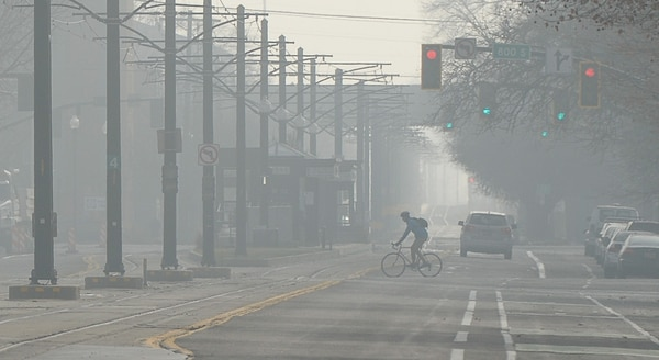 (Francisco Kjolseth | The Salt Lake Tribune) The Salt Lake Valley sees an increase in pollution as a winter inversion settles in trapping cold air on Monday, Dec. 11, 2017.