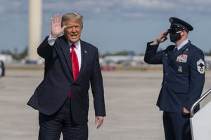 (Manuel Balce Ceneta | AP file photo) Former President Donald Trump waves to the members of the media after his final flight on Air Force One at Palm Beach International Airport in West Palm Beach, Fla., Wednesday, Jan. 20, 2021.