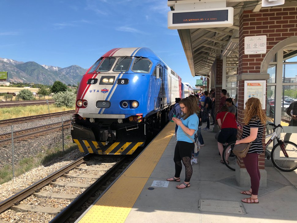 (Lee Davidson | The Salt Lake Tribune) FrontRunner train arrives at Orem station as crowds wait to board on June 27, 2019. Bus and Frontrunner ridership has increased because of free BRT in Provo and Orem and UTA deals with UVU and BYU that make all transit free for students and faculty.