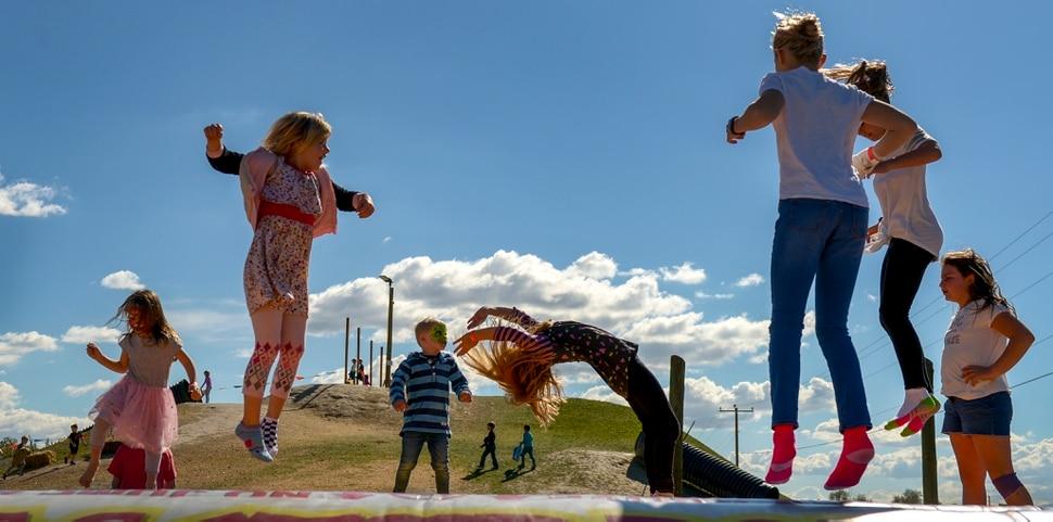 Leah Hogsten | The Salt Lake Tribune Shoeless kids jump on the giant jump pad during the 2018 Fall Festival at Cross E Ranch in Salt Lake City, Thursday Oct. 18, 2018.