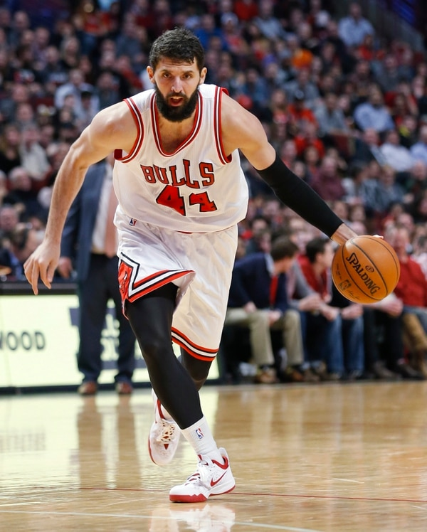 Chicago Bulls forward Nikola Mirotic (44) goes to the basket against the Washington Wizards during the second half of an NBA basketball game, Tuesday, March 3, 2015, in Chicago. The Bulls won 97-92. (AP Photo/Kamil Krzaczynski)