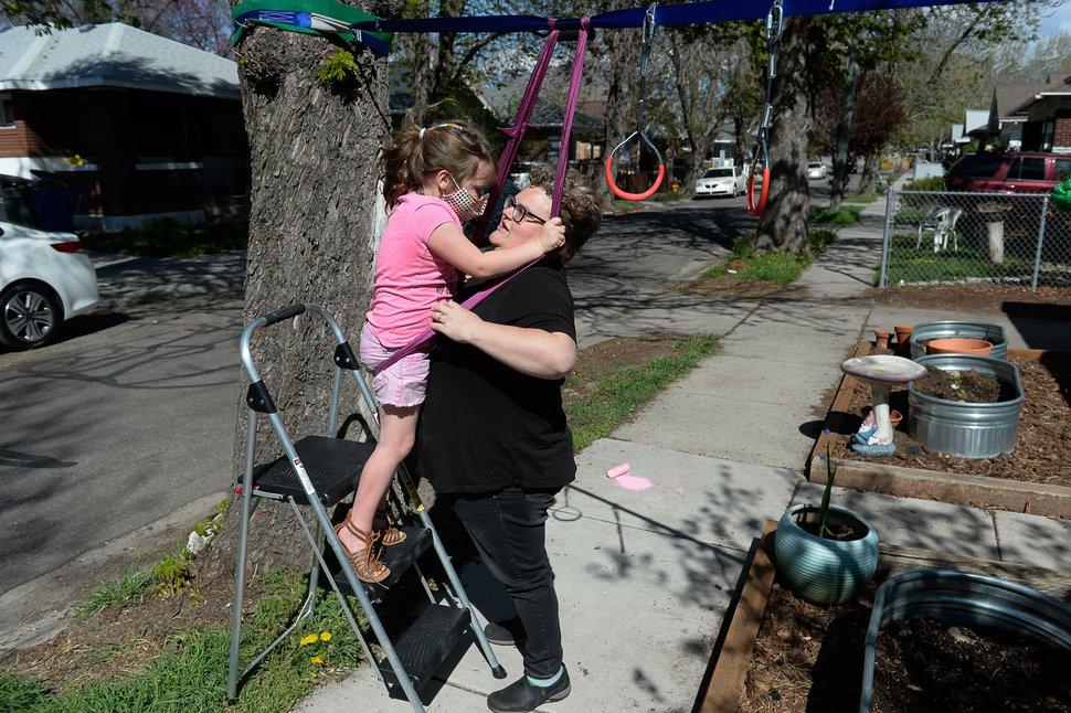 (Francisco Kjolseth | The Salt Lake Tribune) Beth Jennings helps her daughter Hollis, 7, get up to their self described