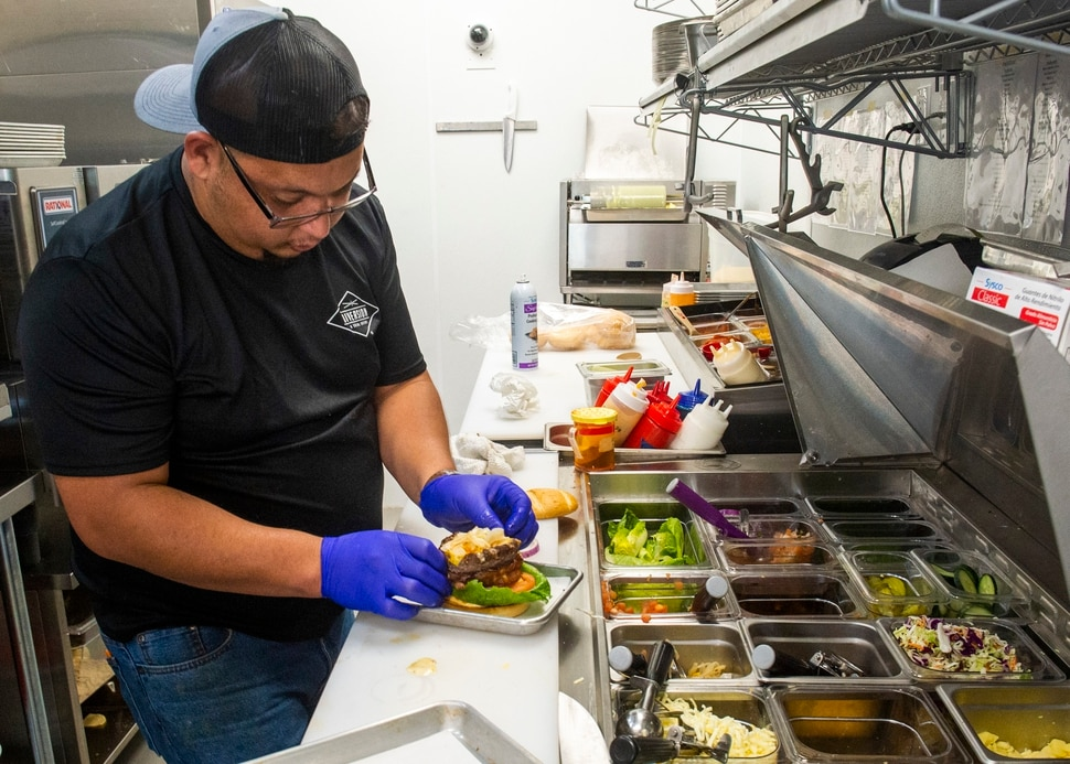 (Rick Egan | The Salt Lake Tribune) Jesus Hernandez builds a Low-carb Burger Bowl, a ground beef patty, shaped into a bowl, baked and then filled with toppings like sautéed mushrooms, onions, bacon at Diversion: A Social Eatery, a new restaurant in Salt Lake City's Marmalade District, Wednesday, Oct. 30, 2019.