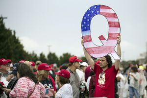 (Matt Rourke   The Associated Press) In this Aug. 2, 2018, file photo, a protester holds a Q sign at a campaign rally for Donald Trump in Wilkes-Barre, Pa. A survey shows Latter-day Saints rank with white evangelicals and Hispanic Protestants as the most likely to believe in the QAnon conspiracy theory.