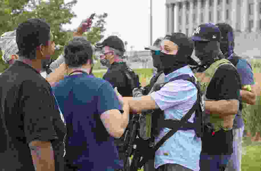 More than 20 armed men show up at Utah Capitol during small demonstration against police violence