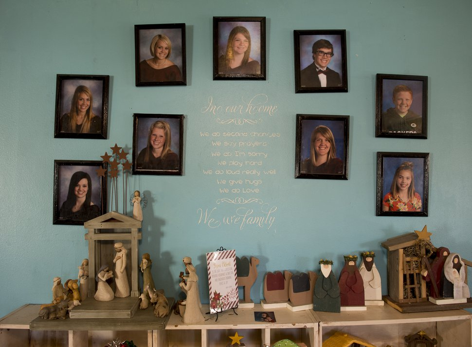 (Leah Hogsten | The Salt Lake Tribune) The living room wall in the Williamson home displays photographs of the Williamson children; l-r Asha, Emma, Alisha, Leah, Alexa, Leland, Sarah, Jimmy and Anna. Ondi Williamson was injured in a 2002 vehicle collision that killed his wife Thanh Williamson and injured his daughter Alexa. The accident set a precedent-setting decision by the U.S. Supreme Court on seatbelt safety requirements.