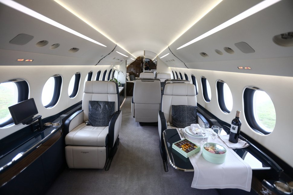 (Simon Dawson | Bloomberg) A table setting for a meal sits inside a Falcon 7X business jet, manufactured by Dassault Aviation SA.