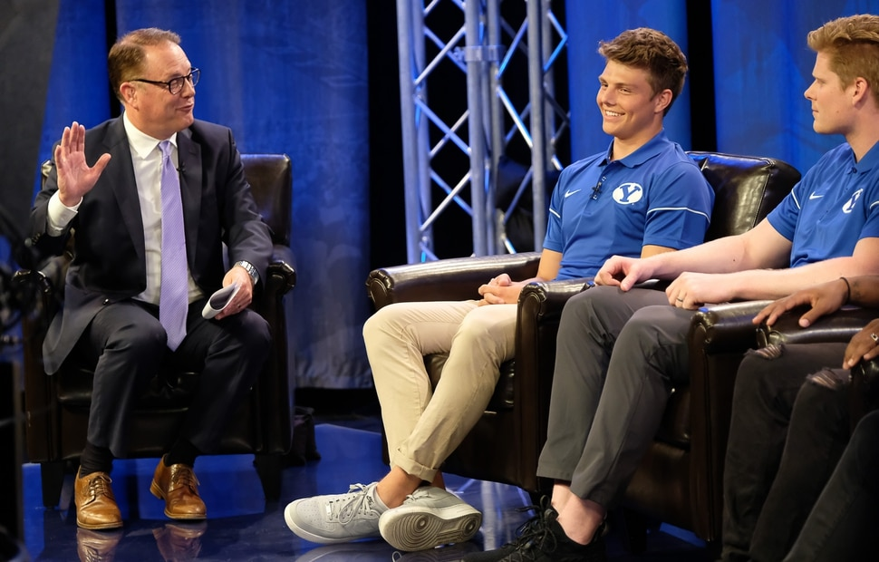 (Francisco Kjolseth | The Salt Lake Tribune) Dave McCann interviews BYU quarterback Zach Wilson, center, and tight end Matt Bushman during a live broadcast on BYUTV during BYU football media day at the BYU Broadcasting Building in Provo on Tuesday, June 18, 2019.