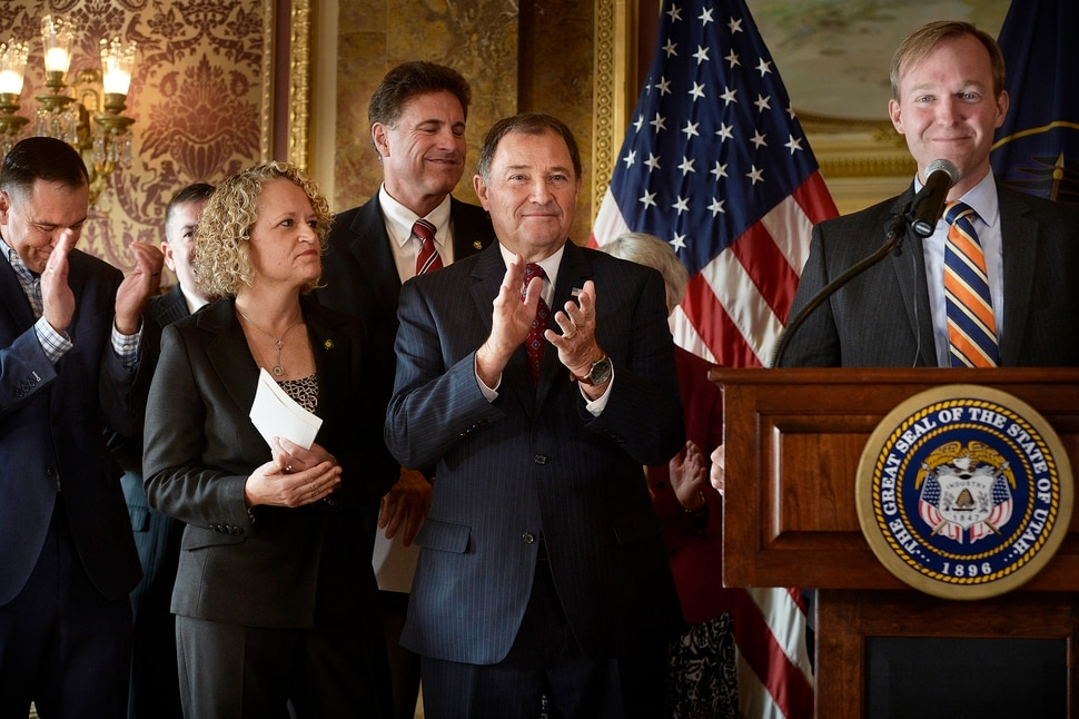 (Scott Sommerdorf | The Salt Lake Tribune) Utah Governor Gary Herbert gets a round of applauds at center as Salt Lake County Mayor Ben McAdams speaks from the podium after the Governor announced a plan that expands Medicare coverage in Utah, Wednesday, November 1, 2017. From left to right; House Speaker Greg Hughes, R-Draper Salt Lake Mayor Jackie Biskupski Representative Jim Dunnigan, R-Taylorsville, Utah Governor Gary Herbert, and McAdams.