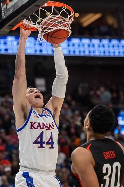 (Trent Nelson | The Salt Lake Tribune) Kansas Jayhawks forward Mitch Lightfoot (44) dunks over Northeastern Huskies center Anthony Green (30) as Kansas faces Northeastern in the 2019 NCAA Tournament in Salt Lake City on Thursday March 21, 2019.
