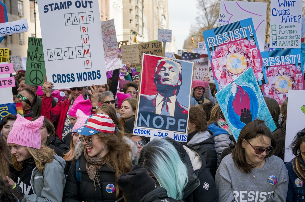 People take part in a rally portion of a march highlighting equal rights and equality for women Saturday, Jan. 20, 2018, in New York. The New York protest was among more than 200 such actions planned for the weekend around the world. (AP Photo/Craig Ruttle)
