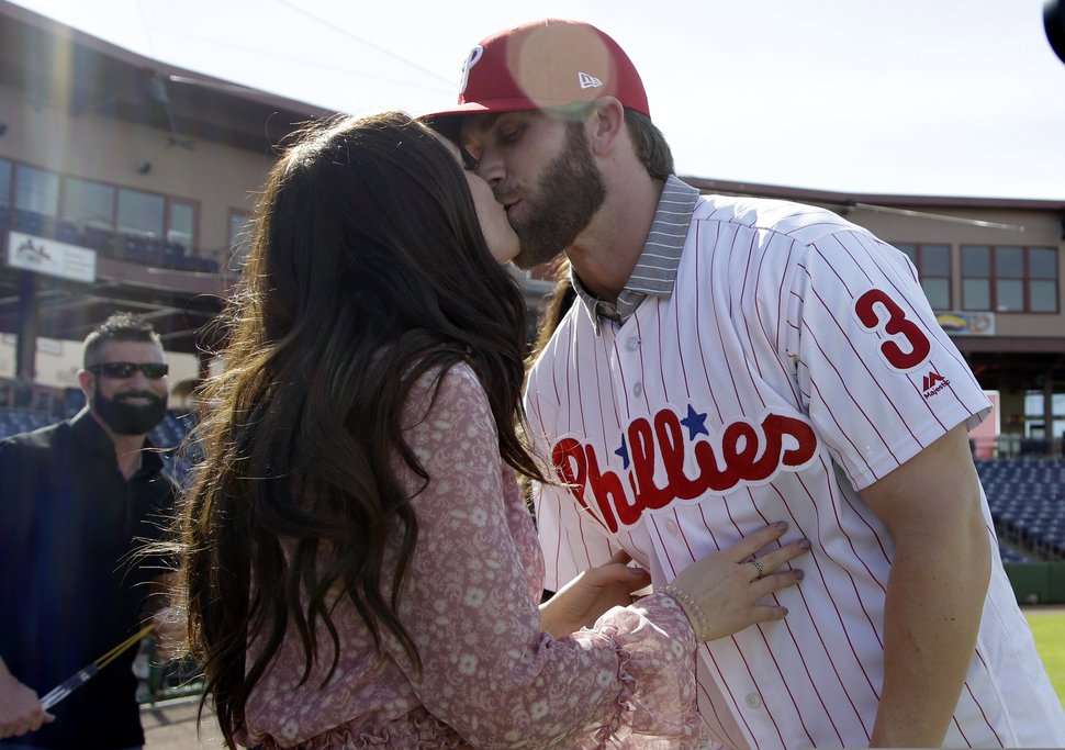 (Lynne Sladky | AP file photo) Bryce Harper kisses his wife, Kayla, after being introduced as a Philadelphia Phillies player during a news conference at the team's spring training baseball facility, Saturday, March 2, 2019, in Clearwater, Fla.