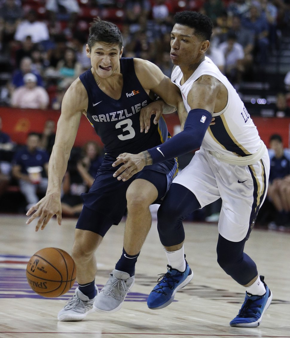 Memphis Grizzlies' Grayson Allen drives around New Orleans Pelicans' Marcos Louzada Silva during overtime of an NBA summer league basketball game Sunday, July 14, 2019, in Las Vegas. (AP Photo/John Locher)