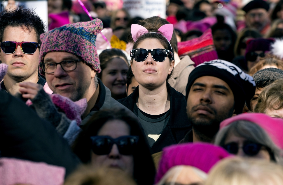 People stand quietly during a moment of silence as they take part in a rally and march highlighting equal rights and equality for women Saturday, Jan. 20, 2018, in New York. The New York protest was among more than 200 such actions planned for the weekend around the world. (AP Photo/Craig Ruttle)