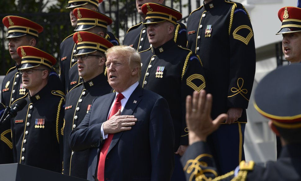President Donald Trump sings the National Anthem with the U.S. Army Chorus during a