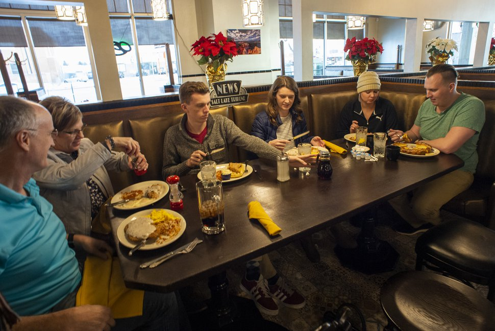 (Rick Egan | The Salt Lake Tribune) The Eyre family — Ron, Julianne, Kaden, Ashley, Channing and Jordan — dine at Tru Religion Pancake & Steakhouse, which opened recently in Orem. The restaurant features antique furniture from Salt Lake City's iconic Lambs Grill. Friday, Dec. 28, 2018.