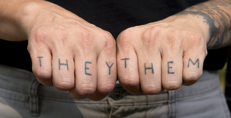 Leah Hogsten | The Salt Lake Tribune l-r Lesley Shaw's finger tattoos show how they identify as a transgender person. Shaw says they experienced inappropriate behavior by Davis County officers after their July 12, 2018 arrest at Management and Training Corporation for suspicion of trespassing, disorderly conduct and resisting arrest during a protest of the MTC's operations of Immigration and Customs Enforcement (ICE) detention centers in California, New Mexico and Texas. For Shaw, it was invasive line of questioning into their transitioning and was asked to expose their chest and back tattoos for photographs, something not asked of the other seven who were arrested.