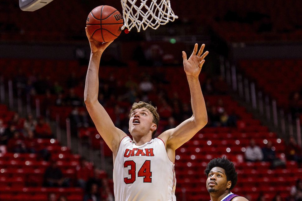 Utah forward Jayce Johnson (34) shoots in front of aNorthwestern State player during an NCAA college basketball game in Salt Lake City, Wednesday, Dec, 20, 2017. (Trent Nelson/The Salt Lake Tribune via AP)