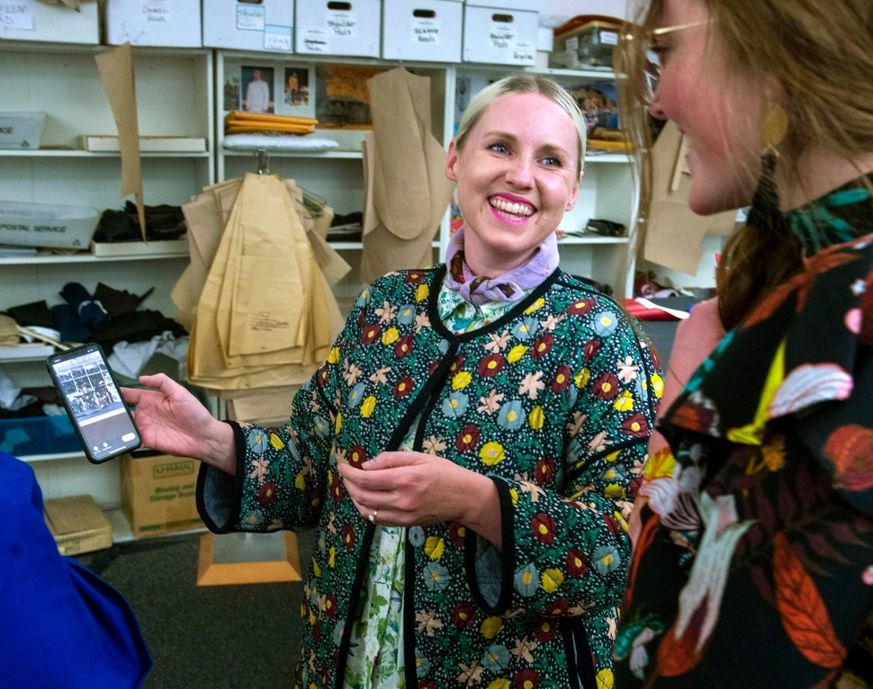 (Rick Egan | The Salt Lake Tribune) Social media influencer Brittany Jepsen shares a photo with Hannah Lewis in the Utah Opera costume shop during a preview event for Norma, at the Utah Opera Production Studios, Monday, April 15, 2019.