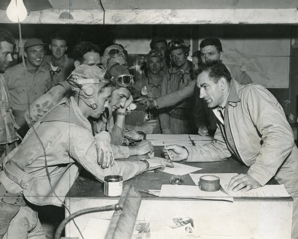 (Photo courtesy of the Wisconsin Historical Society) Joseph McCarthy interviews pilots who just returned from raids on Japanese installations in the Solomon Islands during World War II.