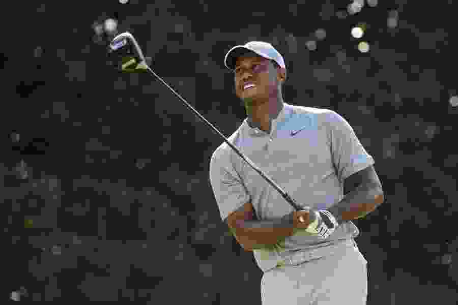 Tiger Woods shares lead going into weekend at the Tour Championship