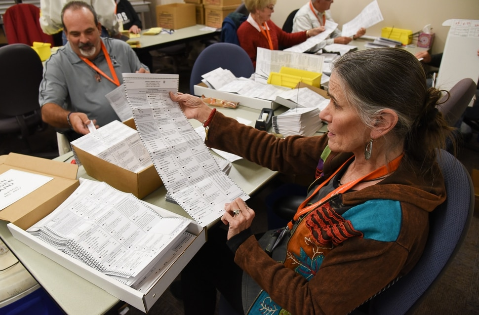 (Francisco Kjolseth | The Salt Lake Tribune) Temporary elections workers Darrell Cole, left, and Ursula Jochmann check for any ballot problems as they process mailed in ballots on Tuesday, Oct. 30, 2018. Turnout numbers from the State Elections Office showed 359,219 people out of 1,390,679 active Utah voters have already cast their ballots as of Tuesday morning. Ten Salt Lake County early voting locations will open on Wednesday, but 1,059 voters have already taken advantage of voting at the Salt Lake County government offices. While many have already cast their ballots, there are some Utahns who haven't received theirs in the mail yet, which may create obstacles for them to vote.
