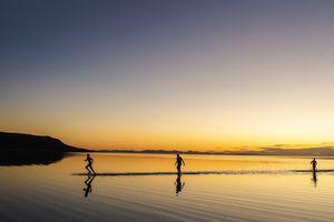 (Rick Egan | The Salt Lake Tribune) Greg Carr, Sam Rushforth and Austin Wintle from Centerville, UT, head back to the shore after floating in the Great Salt Lake. Wednesday, Sept. 18, 2019.