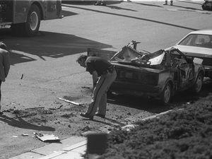 (Tribune file photo) Investigators examine Mormon forger Mark Hofmann's blown-up car in 1985.